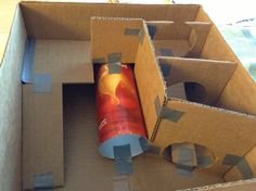 Hamster maze! It's amazing what you can do with a Pringles can, cardboard box, and some duct tape...