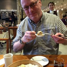 Mr. Jones devouring soup dumpling at Din Tai Fung in Taipei, Taiwan