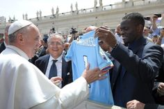 Pope Francis receives a jersey as a gift from Lazios player Saha during his weekly audience at the Vatican  Pope Francis receives a jersey as a gift from Lazios soccer player Louis Saha during the popes weekly audience in St. Peters Square at the Vatican May 22. (CNS photo/LOsservatore Romano via Reuters)