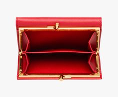 Saffiano Triangle leather flap wallet Gold-plated hardware Enamel triangle logo Snap closure Seven credit card slots One document pocket One bill compartment One coin compartment with springe-hinge closure