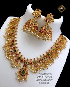 Beautiful one gram gold necklace with guttapusalu hangings. Necklace studded with multi color CZs. necklace with matching earrings. 1 Gram Gold Jewellery, Gold Jewellery Design, Temple Jewellery, Gold Choker, Gold Earrings, Gold Necklace, Jewellery Earrings, Necklace Set, Jewelry Stand