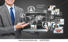 Portrait of business man with laptop showing social connected on a virtual background