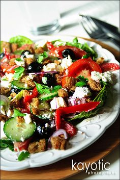 Greek Salad (bread, romaine lettuce, garlic, oil, bell pepper, tomato, cucumber,  black olives, red onion, feta)  Dressing (olive oil, yogurt, Dijon mustard,  lemon juice, oregano, salt)