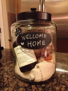 Great housewarming gift, glass canister, hand soap, pumpkin hand towels and some chocolate meringues