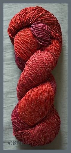 Blue Heron Yarn.. color: Carnelian: Rayon Metallic Soft and silky with great drape and a bit of metallic sparkle, this is our most popular yarn. One skein will make a shawl