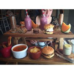 What you are looking at is a mini picnic bench of afternoon tea, including mini bacon burgers, shepherds pie, millionaires shortbread and those fruit smoothie ice cream bottles. Today was a good day. #foodie #instafood #afternoontea