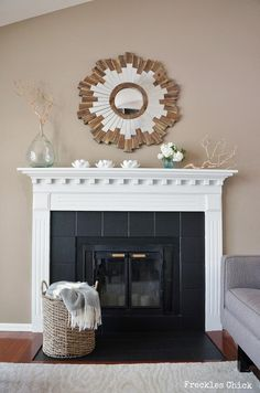 Painted fireplace tiles. Worth a try instead of replacing with black marble. Cost savings!