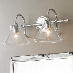 """Beaker Glass Bath Light - 2 Light It's clear to see that this bath or vanity light is a modern inspiration of a vintage beaker sconce. Available in 2 light, three light or as a single sconce itself this is a great addition to a bathroom. Available in Chrome, Oil Rubbed Bronze, Antiqued Nickel, and Brushed Brass. (2) 100watt medium base max. (9.3""""Hx19.3""""Wx9.8""""D)"""