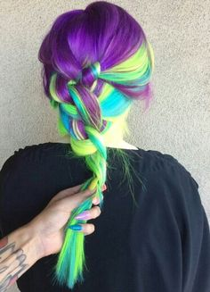 Dark purple neon green dyed hair color.