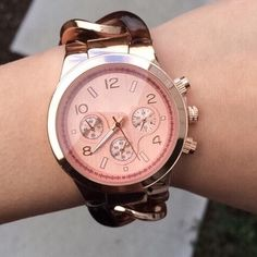 "Rose Gold & Tortoise Link Watch Rose gold and tortoise link watch. Fold over clasp closure. Watch band can be adjusted to fit your wrist by removing links. Nickel and lead free. Measures approx. 8"" long. Photo credit T&J Designs. T&J Designs Accessories Watches"