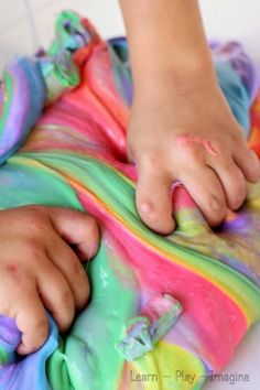 Rainbow slime recipe: equal parts Elmer's school glue and liquid starch. Add liquid watercolor paint or food coloring.