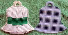 Handmade Plastic Canvas Christmas Bell with cut out measures about 4 1/2 X 4 Can be made into Ornament, Magnet, Coaster or package decoration. Cute to put in a Christmas Card.