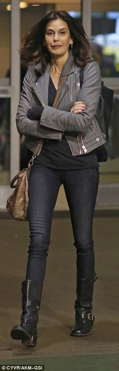 Leggy lady!She slipped her slim pins into a pair of skinny jeans and chunky black boots, ...