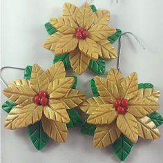 Gold Poinsettias www.teeliesfairygarden.com Gold poinsettias are beautiful and lucky in the fairy home, especially when hanging on their front door. Your fairies will love these gold poinsettias. #fairypoinsettias