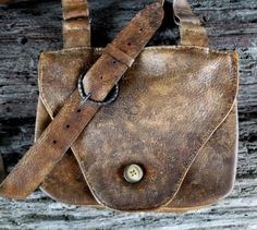 Double Pouch Mountain Man Possibles Bag with knife sheath on the back. Hand wrought iron buckles and strap rings with antique horn button. Hand sewn and created by Miss Tudy Per custom request, next pictures shows knife sheath back.