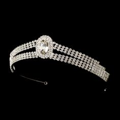 """Beautiful silver coloured royalty inspired bridal tiara headpiece with large sparkling oval centre crystal.  Crystal Design extends 7"""" by 1 1/4"""" tall on 14"""" band with end loops."""