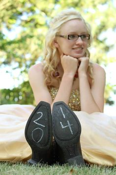 Love the prom dress with the cowboy boots! :) Great senior picture!
