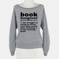 Book hangover. Noun. The struggle of trying to reconnect with reality after finishing a really amazing book. All bookworms, nerds, and avid readers know the feeling of finishing that book and not... | Beautiful Designs on Graphic Tees, Tanks and Long Sleeve Shirts with New Items Every Day. Satisfaction Guaranteed. Easy Returns.