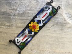 A personal favorite from my Etsy shop https://www.etsy.com/listing/465952659/authentic-huichol-beaded-bracelet-with