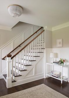 White And Gray Entry Boasts Upper Walls Painted Soft Gray And Lower Walls  Clad In Board