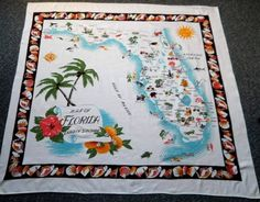 Neat vintage tablecloth! The shell border and large palm trees really add to its appeal.