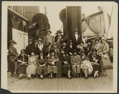 Seated front row, fourth person from the left is Alva Belmont (Mrs. Oliver H. P. Belmont) aboard Cunard's RMS Tuscania (May 1926) enroute to Paris as part of the US National Women's Party delegation to the International Woman Suffrage Alliance Congress.