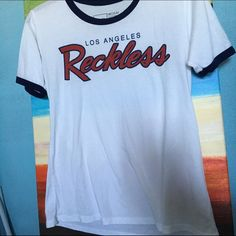 Young and Reckless Tee EXCELLENT CONDITION In excellent condition. 50% cotton and 50% polyester Tops Tees - Short Sleeve