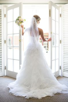 Strapless white dress with a ruffled skirt and sweetheart neckline