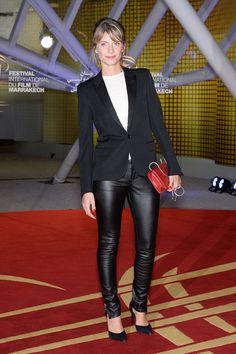 Mélanie Laurent in black leather pants, white tee, black blazer, heels.