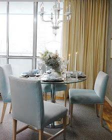 Love this dining room in light blue velvet & cream curtains.