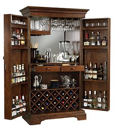 Alcohol armoire..... kind of an awesome way to have an in home bar and being able to hide it... and lock it up.... hmmmmm ;)