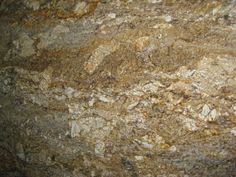 caramel colored granite | Description : Chunky veins of golden brown and taupe on a cream ...