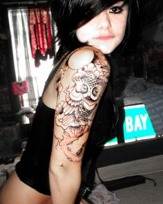 I want an owl tattoo with my school colors and I really like this placement & the background work :)    Google Image Result for http://fc00.deviantart.net/fs71/i/2010/135/f/4/New_Owl_Tattoo_by_xmellowdeex.jpg