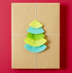 Sweet idea      Folded cupcake liners, plain paper and twine go together for a simple but striking wrap, especially for kitchen-related gifts. Use a mini liner for the top.