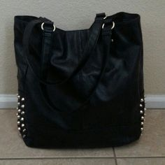 """Studded Totebag Chic totebag in black vegan leather with matte distressed goldtone studs.one small zipper compartment inside and two cell phone pockets. Length 14"""" plus 9"""" handle drop Width 15"""" Depth 5"""" Excellent condition! Boutique Bags"""
