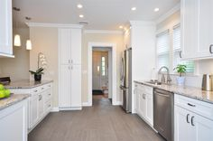 white shaker kitchen | ice white shaker cabinets, grey tile flooring, parchment paint, stainless steel
