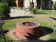 This low-cost, easy-to-assemble fire pit from Instructables is made with concrete tree rings and rocks. Just add a grill and you've got the perfect backyard hangout, all for around $50. data-pin-do=