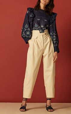 The designer: Comfortable *and* stylish, the easy-chic of the New York based line, designed by Monica Paolini and Sean Monahan, is impossible to resist.  This season it's about: Doing what Pre-Fall should: offer white blouses and summer dresses to wear as soon as they deliver (around May) as well as plaids, fun suiting and daytime jumpsuits to take you through fall.