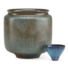 """OTTO NATZLER (1908 - 2007); GERTRUD... OTTO NATZLER (1908 - 2007); GERTRUD NATZLER (1908 - 1971); Straight-walled vessel, Steel Blue Mat glaze, and miniature bowl, Blue Mariposa glaze, Los Angeles, CA, 1961/66; Vase signed NATZLER, paper label L322, bowl signed N with paper label, C46; 4"""" x 4"""", miniature: 1 1/2"""" x 1 1/2""""; Provenance: Sold by the Museum of Fine Arts, Boston for the benefit of the collection"""