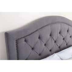 This durable tufted headboard from Abbyson Living provides a stylish, classic accent for your queen- or king-size bed. Made from real wood and 100 percent polyester velvet, this velvet headboard offer