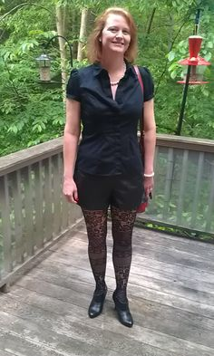 Fun outfit. black faux leather shorts and cool textured tights