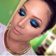 Blue eyeshadow paired with nude lips