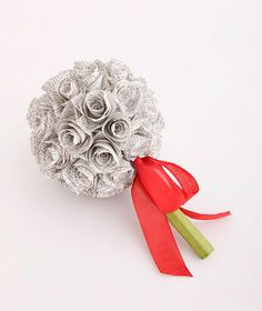 """Book Bouquet - The ceremony isn't the only place to incorporate a favorite reading or song. This one-of-a-kind arrangement features hand-rolled """"flowers"""" crafted using the pages (or photocopies) from the couple's favorite book or sheet music."""