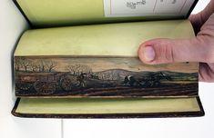 Pinturas secretas em bordas de livros do século XIX