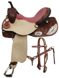 Double T Barrel Style Saddle Set with Cowgirl Up Engraved Silver. This saddle features Medium oil floral tooled skirts, pommel and cantle. Pink filigree top grain leather seat. Rough out fenders and j