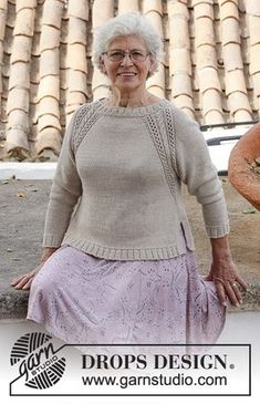Knitted jumper with raglan, cables, lace pattern and split in sides, worked top down. Sizes S - XXXL. The piece is worked in DROPS Cotton Light.