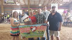 Canfield Fair Res. Champion Cathy McCracken with Minerva Dairy Employee Jack Ling - 2014