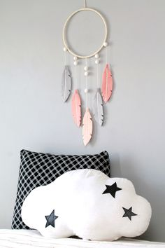 Gorgeous (modern) bohemian felt feather dreamer by Ordinary Mommy Design.
