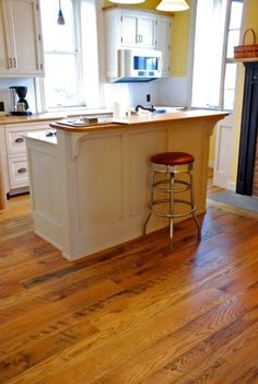 quarter sawn white oak random width plank floor with black walnut