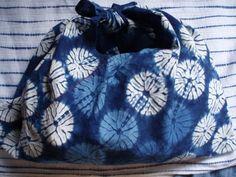 Stitch resist shibori, indigo dyed